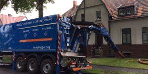 Keller mit Saugbagger aussaugen